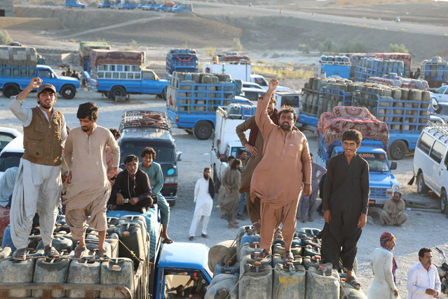 Pakistani traders, who deal in the Iranian gasoline trade across the border, protest after the Pakistani government banned smuggled Iranian gasoline, in Panjgor, Balochistan province, Pakistan, 26 October 2019. According to reports, millions of gallons of fuel illegally leaves Iran each month. (Photo by Jamal Taraqai/EPA/EFE)