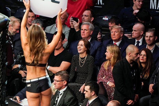 House Minority Leader Kevin McCarthy (R-CA) and U.S. President Donald Trump watch a woman carry a card announcing the rounds during a mixed martial arts fight in Madison Square Garden in New York, New York, U.S., November 2, 2019. (Photo by Joshua Roberts/Reuters)