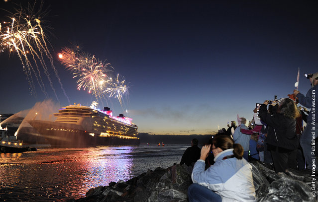 Fireworks light the morning sky March 6, 2012 as the Disney Fantasy, the newest Disney Cruise Line ship, arrives in her home port of Port Canaveral, Florida after traveling nearly 4,700 miles across the Atlantic Ocean from Bremerhaven, Germany