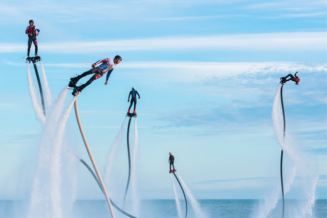Participants in the Flyboard Record international extreme water sports festival in the Black Sea, offshore from Sochi's Sport Inn hotel on May 21, 2017. (Photo by TASS/Barcroft Images)