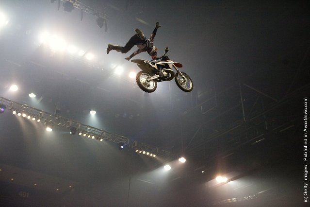 A motocross acrobat races at the Night of the Jumps freestyle motocross acrobatics at O2 arena