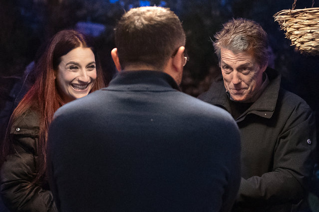 Actor Hugh Grant and Liberal Democrat Luciana Berger (L) speak to a local resident during a campaign event in Finchley on December 1, 2019 in London, England. UK voters are set to go to the polls on December 12 in the country's third general election in less than five years. (Photo by Leon Neal/Getty Images)