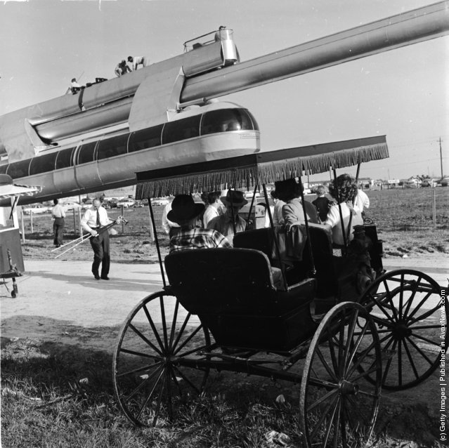 1950:  Passengers queue for a free ride on a new monorail service in Houston, Texas