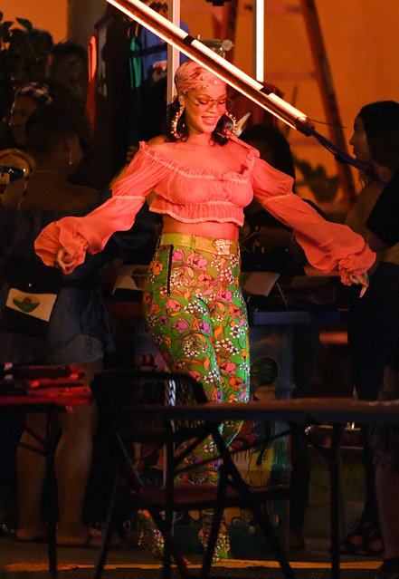 Rihanna is seen filming a music video wit DJ Khaled in the Little Haiti neighborhood of Miami, FL on June 5, 2017. The pop star showed off her nipple piercing in two sheer tops, and was seen frequently patting her face with a napkin due to the sweltering heat in the city. For the finale of the Caribbean themed video, fireworks exploded over a stage where the two performers were being filmed. (Photo by INSTARimages.com)