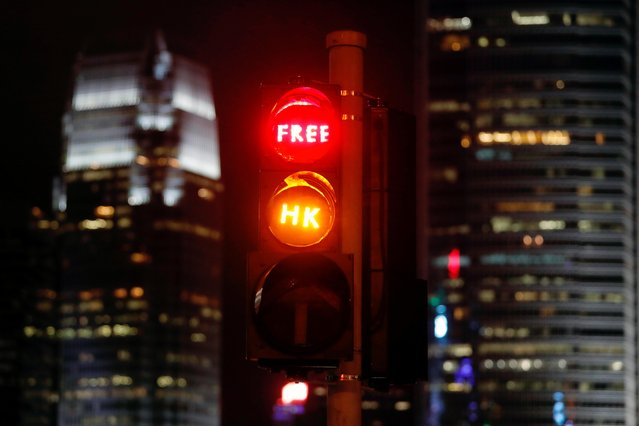"""""""Free HK"""" is seen placed on traffic lights by anti-extradition bill protesters, outside the Chief Executive's Office in Hong Kong, September 2, 2019. (Photo by Tyrone Siu/Reuters)"""