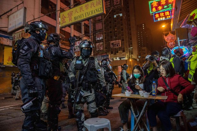 Riot police confront customers at a street food store during anti-government demonstrations in Hong Kong on Christmas Eve December 24, 2019. (Photo by Geovien So/Sopa Images/Zuma Wire/Alamy Live News)