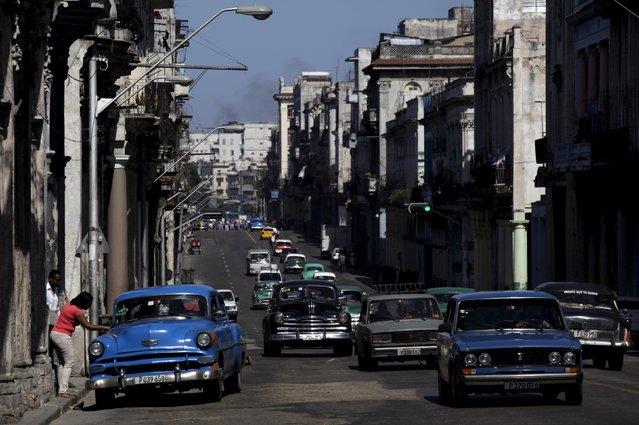 Cars drive through the streets of Havana April 14, 2015. (Photo by Enrique De La Osa/Reuters)