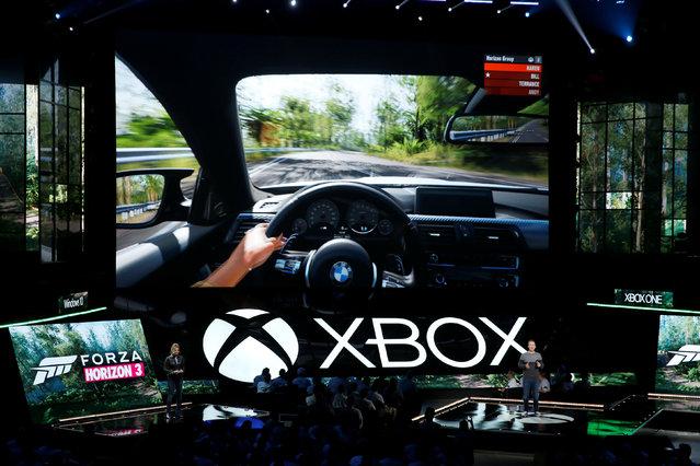 Ralph Fulton (R) presents Microsoft Xbox's Forza Horizon 3 at the Xbox E3 2016 media briefing in Los Angeles, California, U.S., June 13, 2016. (Photo by Lucy Nicholson/Reuters)