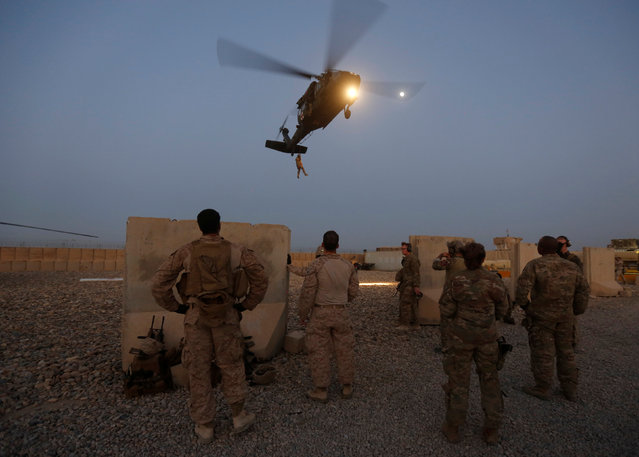 U.S. troops take part in a helicopter Medevac exercise in Helmand province, Afghanistan, July 6, 2017. (Photo by Omar Sobhani/Reuters)