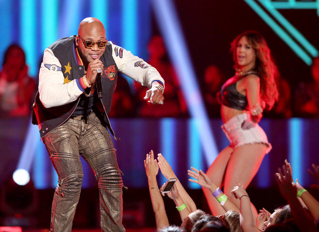 "Flo Rida performs ""I Don't Like It, I Love It"" at the Teen Choice Awards at the Galen Center on Sunday, August 16, 2015, in Los Angeles. (Photo by Matt Sayles/Invision/AP Photo)"