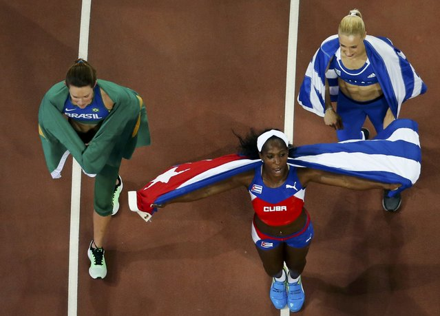 Third placed Fabiana Murer of Brazil, first placed Yarisley Silva of Cuba and second placed Nikoleta Kyriakopoulou of Greece (L-R) celebrate after the women's pole vault final at the 15th IAAF World Championships at the National Stadium in Beijing, China, August 26, 2015. (Photo by Fabrizio Bensch/Reuters)