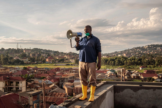 Gonzaga Yiga, a 49-year-old community chairperson, appeals to residents through a speaker from the tallest building of the area in morning and evening, on how to curb the COVID-19 coronavirus, in Kampala, Uganda, on March 24, 2020. (Photo by Badru Katumba/AFP Photo)