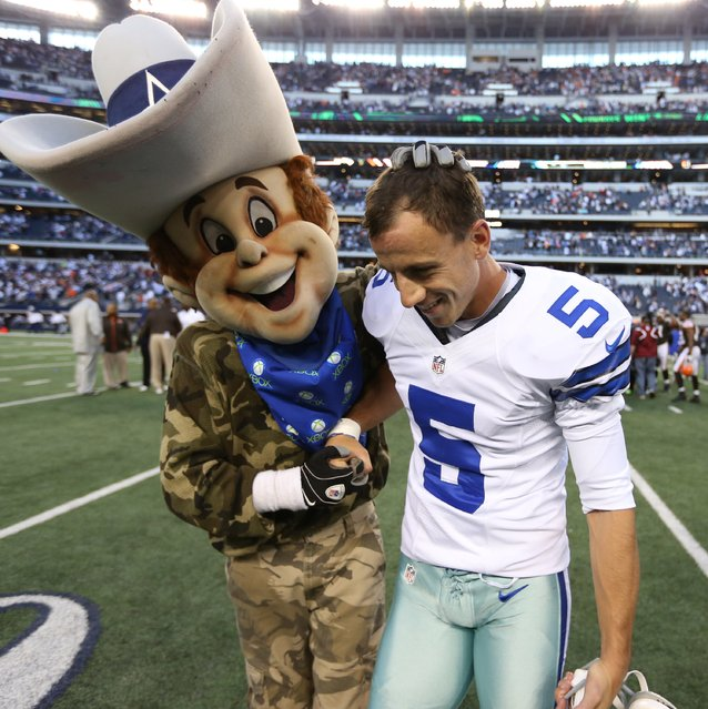 Dallas Cowboys kicker Dan Bailey (5) celebrates kicking the game winning field goal in overtime with mascot Rowdy against the Cleveland Browns at Cowboys Stadium, 2012-11-18. (Photo by Matthew Emmons/US Presswire)