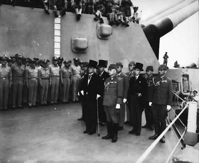 Japan's delegation gather to sign the formal surrender document on the U.S. Navy battleship USS Missouri in Tokyo Bay in a September 2, 1945 file photo. (Photo by Reuters/US Air Force)
