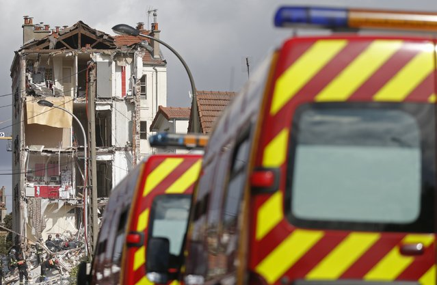 French firefighters search the rubble of a collapsed building in Rosny-Sous-Bois, near Paris August 31, 2014. A four-story building was rocked by an explosion and collapsed, killing a child, in a northeastern suburb of Paris on Sunday morning, French authorities said. Ten people, including four seriously wounded, were evacuated from the rubble of the building, and a child was killed, fire department spokesman Gabriel Plus told iTele. (Photo by Christian Hartmann/Reuters)