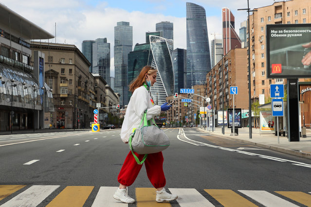 A girl seen on a zebra crossing in Bolshaya Dorogomilovskaya Street during the ongoing COVID-19 pandemic. Moscow Mayor Sergei Sobyanin made mandatory wearing face masks and gloves in public places and on public transport since May 12. The Moscow authorities also extended the self-isolation regime through May 31 in order to prevent the spread of the novel coronavirus infection. (Photo by Gavriil Grigorov/TASS via Getty Images)