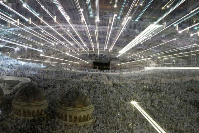 Muslim pilgrims pray around the holy Kaaba at the Grand Mosque, during the annual Hajj pilgrimage in Mecca September 27, 2014. (Photo by Muhammad Hamed/Reuters)