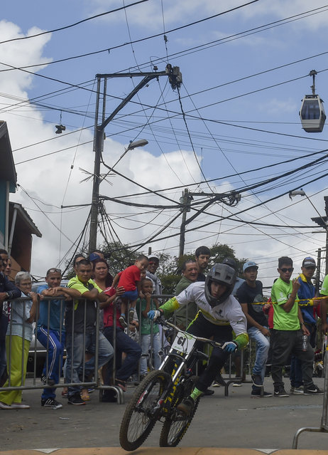 Colombia's downhill rider Andres Cruz competes during the Urban Bike Inder Medellin race final at the Comuna 1 shantytown in Medellin, Antioquia department, Colombia on November 19, 2017. (Photo by Joaquin Sarmiento/AFP Photo)