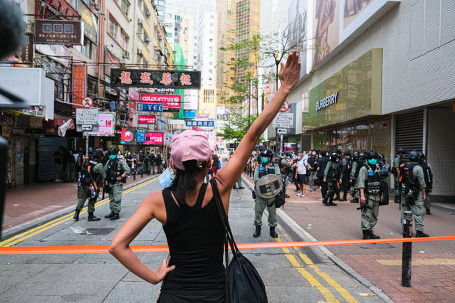 A girl holds up her hand to confront the police during a banned protest in Hong Kong on July 1, 2020. China imposed a controversial national security law on Hong Kong on Tuesday, a historic move that worried many Western governments that will strangle the finance hub's freedoms and hollow out its autonomy. (Photo by Keith Tsuji/Zuma Press/Rex Features/Shutterstock)