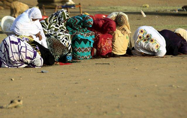 Muslim women gather during Eid al-Adha prayers in Khartoum, Sudan September 24, 2015. (Photo by Mohamed Nureldin Abdallah/Reuters)