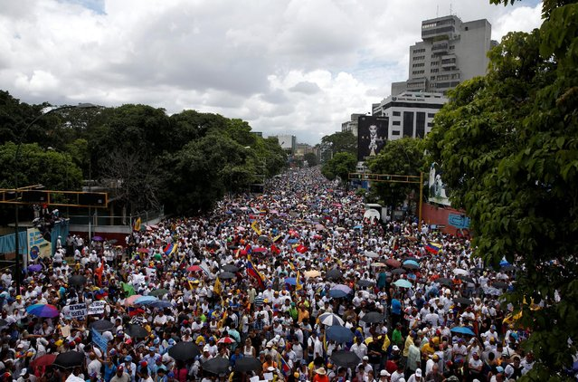 Opposition supporters take part in a rally to demand a referendum to remove Venezuela's President Nicolas Maduro in Caracas, Venezuela, September 1, 2016. (Photo by Carlos Garcia Rawlins/Reuters)