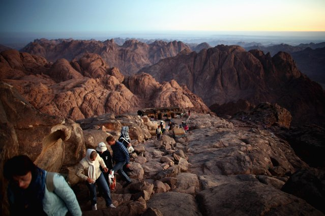 Tourists climb the summit of Mount Moses in the Sinai Peninsula to watch the sunrise, in this October 3, 2006 file photo. (Photo by Goran Tomasevic/Reuters)