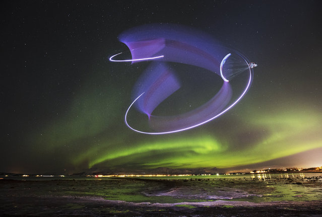 Horacio Llorens performs during the Aurora Borealis in Tromsø, Norway on January 13, 2016. (Photo by Frode Sandbech/Red Bull/SWNS.com)