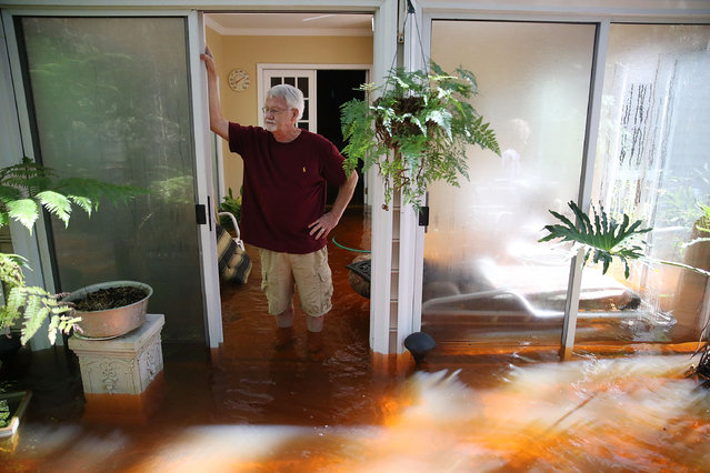 Nelson Shields stands in his flooded home on October 7, 2015 in Summerville, South Carolina.   The state of South Carolina experienced record rainfall amounts over the weekend and officials expect the damage from the flood waters to be in the billions of dollars. (Photo by Joe Raedle/Getty Images)