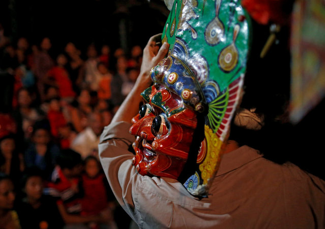 A man carries a mask of a deity after a traditional mask dance during the Indra Jatra festival in Kathmandu, Nepal September 13, 2016. (Photo by Navesh Chitrakar/Reuters)