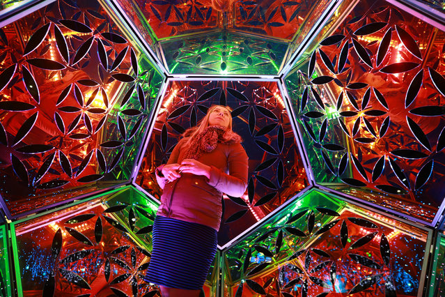 A woman interacts with art installation Dazzling Dodecahedron at the Winter Lights festival at Canary Wharf in East London, Britain, 16 January 2018. The art exhibition runs from 16 to 27 of January across sites at Canary Wharf. (Photo by  Neil Hall/EPA/EFE)
