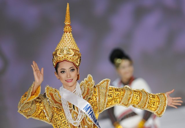 May Bayani Thaw of Myanmar poses in national dress during the 54th Miss International Beauty Pageant in Tokyo November 11, 2014. (Photo by Thomas Peter/Reuters)