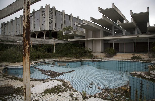 This October 23, 2014, photo shows a swimming pool at the abandoned Palace hotel at deserted tourist resort of Haludovo, near Malinska on the northern Adriatic island of Krk, Croatia. The resort was built as a joint venture of Yugoslav communist government and Bob Guccione, the founder of the Penthouse magazine. The resort was intended as a haven of extreme decadence for upscale vacationers on the Adriatic Sea. Today, it sits abandoned due to ownership issues and mismanagement. (Photo by Darko Bandic/AP Photo)