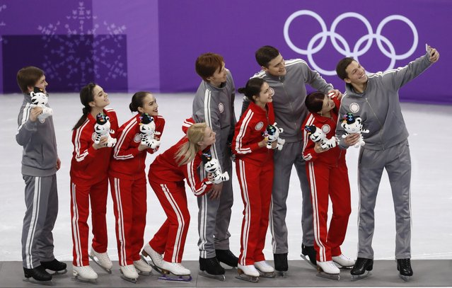 Olympic Athletes of Russia celebrate on the podium after their second place finish in the figure skating team event in the Gangneung Ice Arena at the 2018 Winter Olympics in Gangneung, South Korea, Monday, February 12, 2018. (Photo by Bernat Armangue/AP Photo)