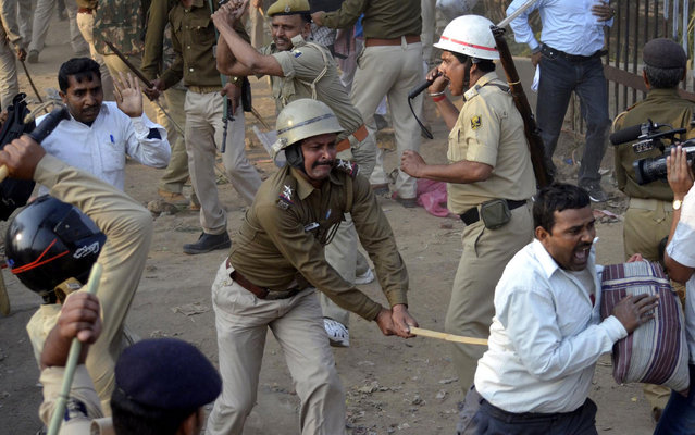 The peaceful protest by a group of contract teachers in Patna, India took a serious turn after the city police resorted to lathicharge against them on Tuesday, March 5, 2013. The protesting teachers had been demanding that their jobs should be made permanent and they should get equal pay for equal work. The lathicharge took place outside the Bihar Assembly. The police even used water cannons and tear gas shells to disperse the protesters. The contractual teachers have protested number of times recently. Last night too, the police used lathicharge on some agitating teachers, which led to a strong protest by the opposition in both Houses of Bihar Legislature today. The opposition has demanded a statement from the government on the incident. (Photo by Krishna Murari Kishan/Reuters)
