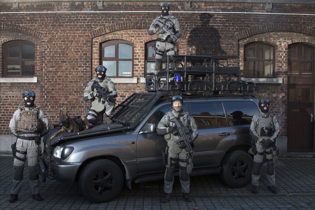 Members of Belgium's special forces pose for pictures at their headquarters in central Brussels on November 24, 2014. Human rights monitors say police in Belgium are legally entitled to use proportionate force, after a warning, where there is no other means to achieve a legitimate objective. They say police may use firearms in self-defense, to confront armed perpetrators, or in defense of persons or key facilities, but never for crowd control. (Photo by Yves Herman/Reuters)