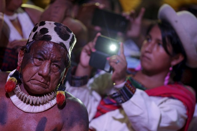 Indigenous people of several tribes watch a presentation by Indigenous people from Kuikuro before the I World Games for Indigenous People in Palmas, Brazil, October 21, 2015. (Photo by Ueslei Marcelino/Reuters)