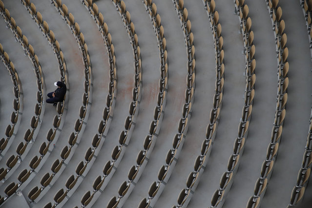 A lone spectator watches Sofia Kenin of the U.S. and Petra Kvitova of the Czech Republic in the semifinal match of the French Open tennis tournament at the Roland Garros stadium in Paris, France, Thursday, October 8, 2020. (Photo by Christophe Ena/AP Photo)