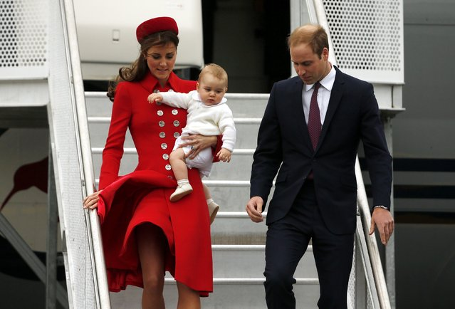 Britain's Prince William, his wife Catherine, Duchess of Cambridge, and their son Prince George disembark from their plane after arriving in Wellington, in this April 7, 2014 file photo. (Photo by Phil Noble/Reuters)