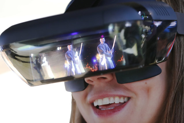 A visitor tries out Lenovo augmented reality glasses with the Star Wars Jedi Challenges during the Mobile World Congress in Barcelona, Spain, February 26, 2018. (Photo by Yves Herman/Reuters)