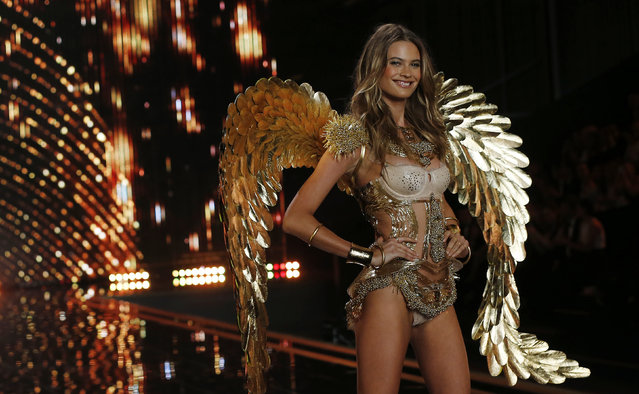 Model Behati Prinsloo presents a creation at the 2014 Victoria's Secret Fashion Show in London December 2, 2014. (Photo by Suzanne Plunkett/Reuters)
