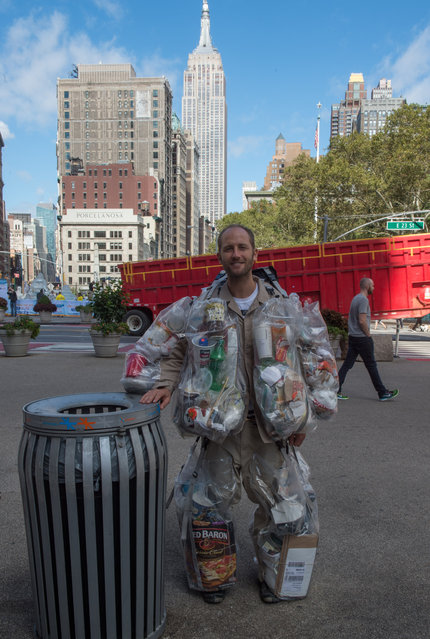 Rob Greenfield, an environmental activist who is spending a month in New York, has hanging on himself all the trash he's produced in ziplog bags on October 4, 2016 in New York. (Photo by Bryan R. Smith/AFP Photo)