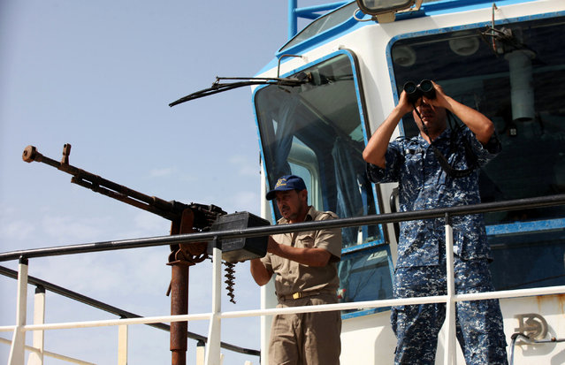 Members of Libyan coastguard stand guard on a ship as they help forces allied with the U.N.-backed government fighting Islamic State militants, off the coast of Sirte, Libya October 6, 2016. (Photo by Hani Amara/Reuters)