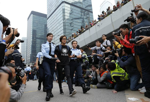 Singer and actress Denise Ho is taken away by policewomen from an area previously blocked by pro-democracy supporters, outside the government headquarters in Hong Kong, December 11, 2014. Hong Kong authorities started on Thursday clearing the main pro-democracy protest site that has choked roads into the city's most economically and politically important district for more than two months as part of a campaign to demand free elections. (Photo by Tyrone Siu/Reuters)