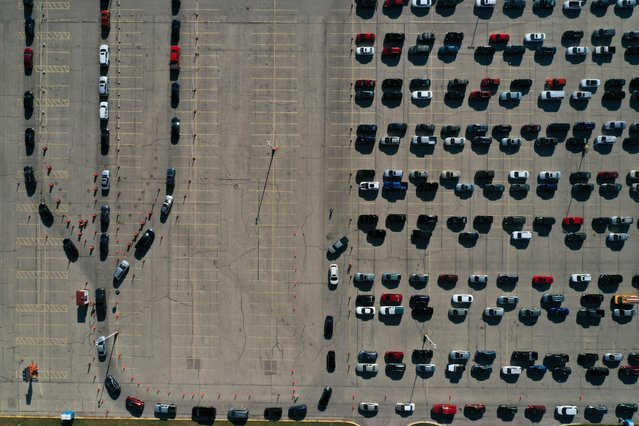 An aerial view of vehicles queuing at a drive-thru COVID-19 testing site at the Alliant Energy Center complex, as the coronavirus disease outbreak continues in Madison, Dane County, Wisconsin, U.S., November 5, 2020. (Photo by Bing Guan/Reuters)