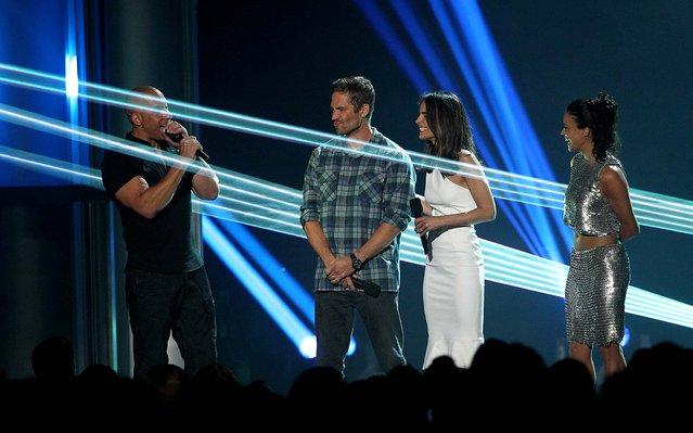 "Vin Diesel, Paul Walker, Jordana Brewster and Michelle Rodriguez, from the cast of ""Fast & Furious"" present the award for breakthrough performance. (Photo by Matt Sayles/Invision)"