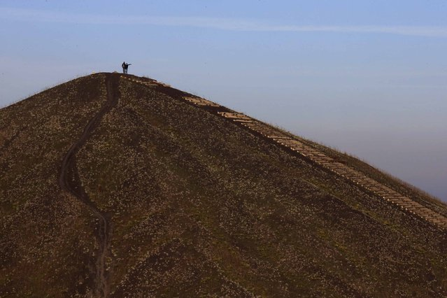 Two hikers stand at the top of one of the 11/19 pit and twin slag heaps at the former coal mine site in Loos-en-Gohelle, northern France, October 31, 2015. (Photo by Pascal Rossignol/Reuters)