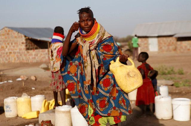 A Turkana woman washes her face at a water point within Kalobeyei Settlement outside the Kakuma refugee camp in Turkana county, northwest of Nairobi, Kenya February 1, 2018. (Photo by Thomas Mukoya/Reuters)