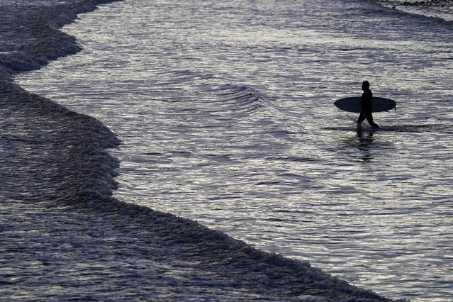 A surfer heads out for an early morning surf at Saltburn beach on October 23, 2020 in Saltburn By The Sea, England. (Photo by Ian Forsyth/Getty Images)