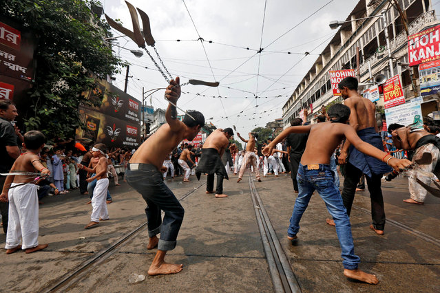 Shi'ite Muslim mourners flagellate themselves during a Muharram procession to mark Ashura in Kolkata, India October 12, 2016. (Photo by Rupak De Chowdhuri/Reuters)