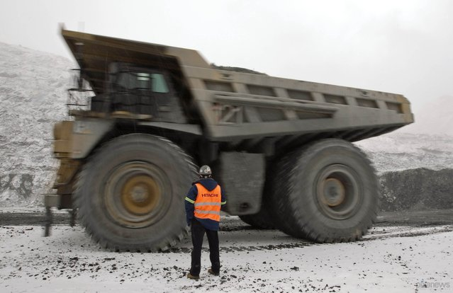 Heavy dump truck. March 14, 2013; Tien Shan mountains, Kyrgyzstan. (Photo by Shamil Zhumatov/Reuters)